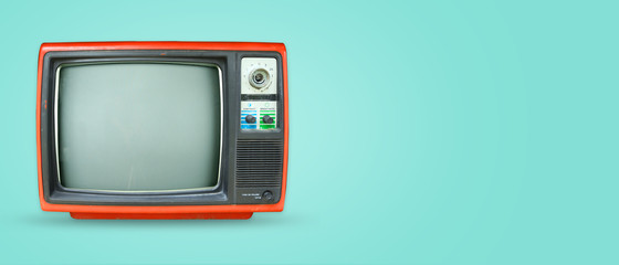Retro television - old vintage tv on color background. retro technology. flat lay, top view hero header. vintage color styles.