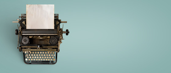 Poster Retro Vintage typewriter header with old paper. retro machine technology - top view and creative flat lay design.