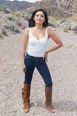 Pretty woman walking on dusty desert trail