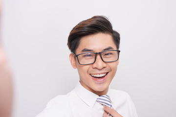 Handsome young asian business man smiling