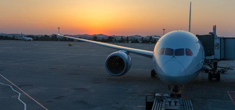 Airplane illuminated by sunset light