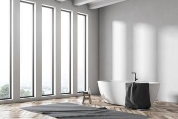 Loft bathroom corner with a white tub