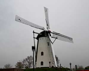 "Windmill in the town of Veldhoven named ""the adriaan"" on dark day in the Netherlands"
