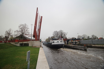 Bridge for Cyclist over the old Rhine river in Leiderdorp is opening for ship