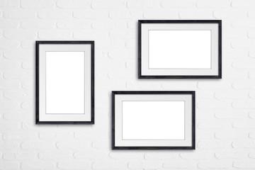 Frames on white bricks wall, interior decoration mock up