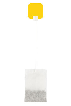 tea bag isolated on white background with yellow label.