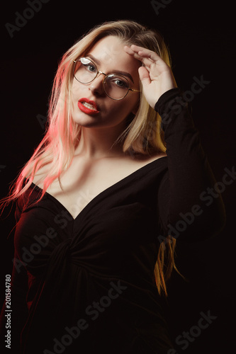 26855a01433 Fashionable blonde model in glasses wearing blouse with naked shoulders