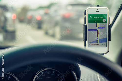 Mobile phones show traffic jam map  View from the inside of