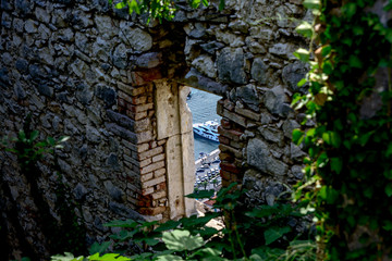 Window in the fortress overlooking the sea