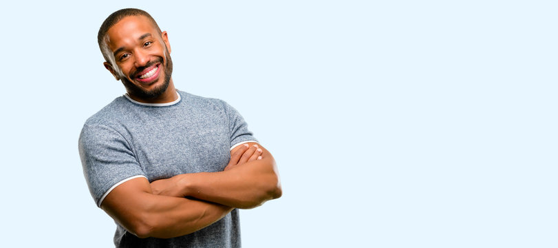 African american man with beard confident and happy with a big natural smile laughing, natural expression isolated over blue background