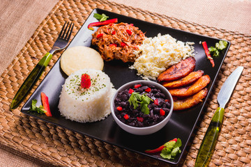 Pabellón criollo, Venezuelan food that has rice, meat, black beans, fried plantain and cheese
