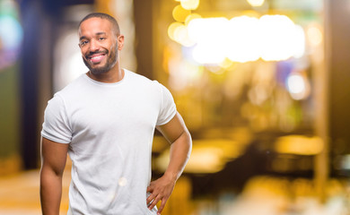 African american man with beard confident and happy with a big natural smile laughing at night