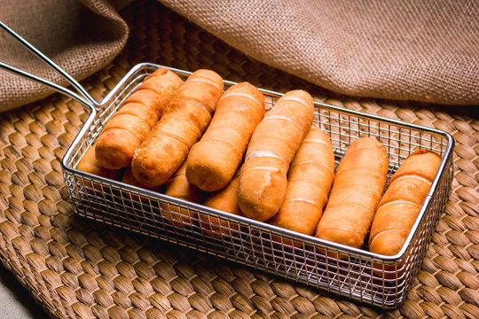 LatinAmerican fast food called Tequeños made of fried corn filled with cheese.