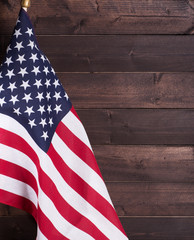 United States flag on a rustic wooden background with copy space