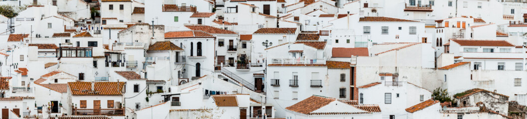 Panorama view of an old spanish town Comares, Andalusia. White facades and reddish-brown roofs