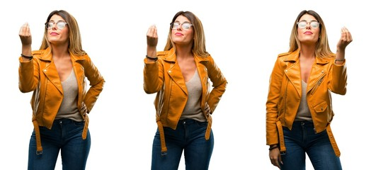 Beautiful young woman angry gesturing typical italian gesture with hand, looking to camera over white background