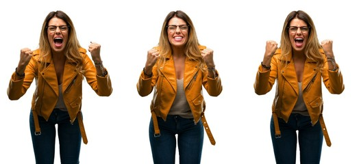 Beautiful young woman happy and excited celebrating victory expressing big success, power, energy and positive emotions. Celebrates new job joyful over white background