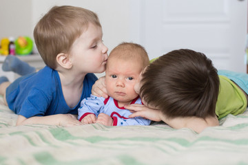 two brothers kissing younger brother