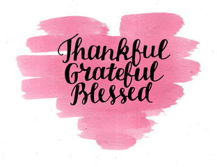Hand lettering Thankful, grateful, blessed on watercolor heart.