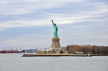 Panorama with Liberty Statue and river isolated on cloudy sky in New York