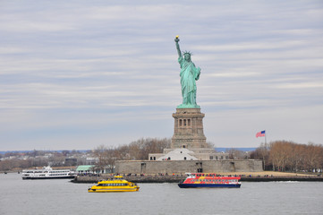 Panorama with the Statue of Liberty with touristic boats in New York