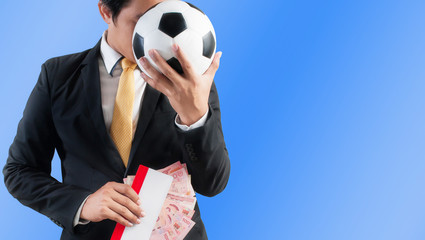 Business holding football or ticket and money, Blue background