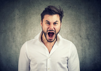 Young man screaming in anger