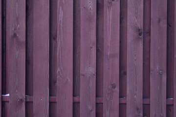 purple wooden fence as background