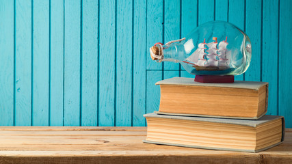 Boat and books on wooden table