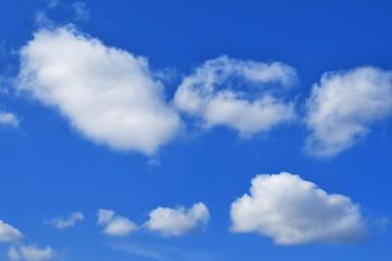 Beautiful white cumulus clouds on blue sky.