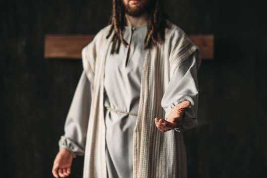 Man in the image of Christ reaching out his hand