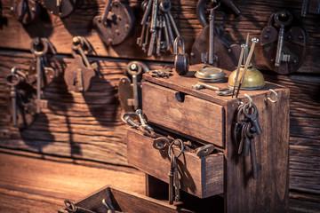 Wooden box with keys and locks in locksmiths workshop