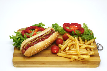 Hot dogs and French fries on white background.