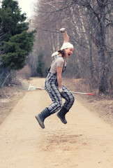Gardener or farmer woman flies on a rake, like a witch on a broomstick. Funny farm life concept.