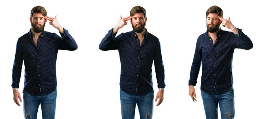 Young man with beard unhappy making suicide gesture, tired of everything. Shoots with his hand imitating gun, upset isolated over white background
