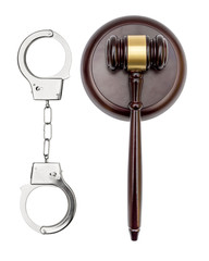 Handcuffs with judge's gavel on white background. Top view. Law concept.