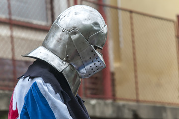 Man in medieval costume wearing steel helmet. Actor during festival in Czech Republic, in Europe