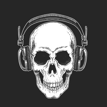 Rock music festival. Cool print for poster, banner, t-shirt. Skull wearing headphones