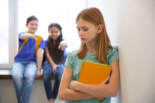 Sad teenage girl indoors. Bullying in school