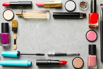 Flat lay composition with decorative cosmetics on gray background