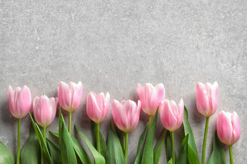 Beautiful tulips for Mother's Day on grey background, top view