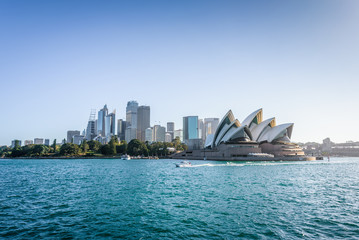 Aluminium Prints Sydney Beautiful sunny coast view to the Skyline and famous Opera House on bright warm day, cruising by ferry from harbour quay bridge to Manly City, Opera House and Quay,Sydney, NSW/ Australia – 10 12 2017