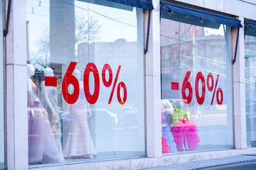 "Moscow, Russia - April, 16, 2018: text ""60%"" on a show window"