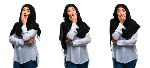 Arab woman wearing hijab scared in shock, expressing panic and fear isolated over white background