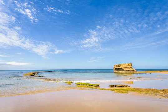 Sunny beautiful summer coast view to blue sea and pure white sand beach dune limestone sandstone rocks perfect for surfing swimming hiking, Great Ocean Road, Torquay, Melbourne, Victoria, Australia