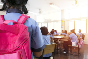 The classroom blur,Girl with red backpack Coming to the classroom