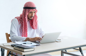 Arabic business people working on laptop in office