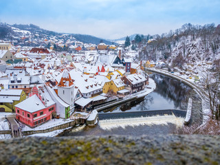 Panoramic view of Cesky Krumlov in winter season, Czech Republic. View of the snow-covered roofs. Travel and Holiday in Europe. Christmas and New Year time. Sunny winter day in european town.