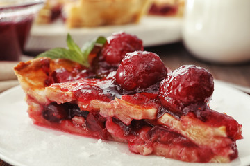 Delicious piece of cherry pie on plate, closeup