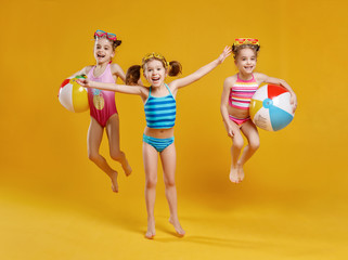 funny funny happy children  jumping in swimsuit  jumping  on colored background.